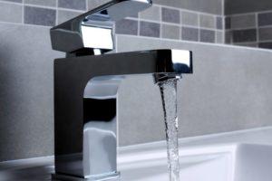 Running water in open faucet.
